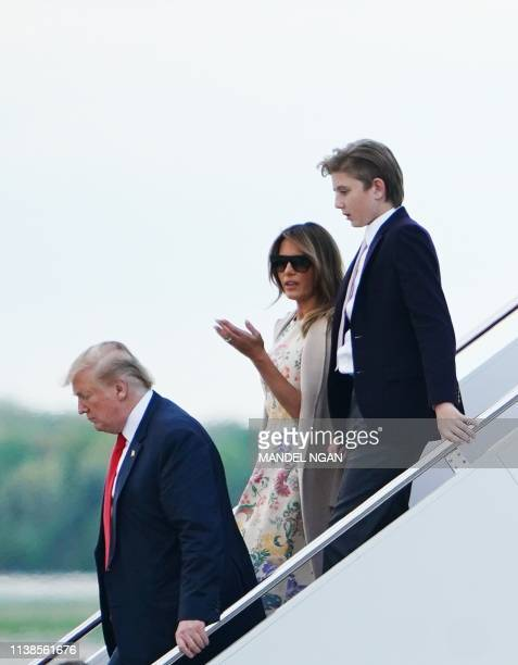 US President Donald Trump First Lady Melania Trump and their son Barron step off Air Force One upon arrival at Andrews Air Force Base in Maryland on...