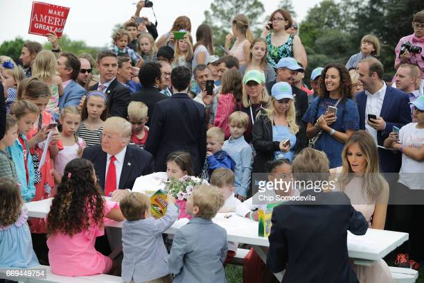 S President Donald Trump first lady Melania Trump and their son Barron Trump join children at a craft table during the 139th Easter Egg Roll on the...