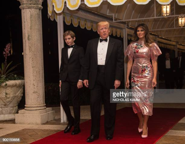 US President Donald Trump First Lady Melania Trump and their son Barron arrive for a new year's party at Trump's MaraLago resort in Palm Beach...