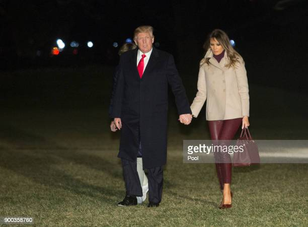 S President Donald Trump first lady Melania Trump and their son Barron Trump return to the White House after their stay at MaraLago in Palm Beach...