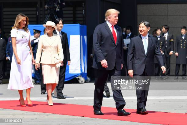 President Donald Trump, First Lady Melania Trump are escorted by Emperor Naruhito and Empress Masako prior to the welcome ceremony at the Imperial...
