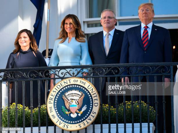 US President Donald Trump First Lady Melania Trump Australian Prime Minister Scott Morrison and his wife Jennifer Morrison look on from a balcony of...