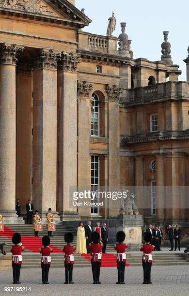 S President Donald Trump First Lady Melania Trump Britain's Prime Minister Theresa May and her husband Philip May on the steps in the Great Court to...
