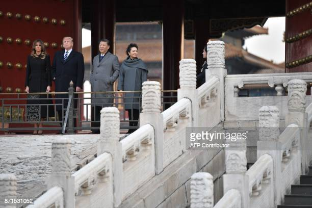 US President Donald Trump First Lady Melania Trump China's President Xi Jinping and his wife Peng Liyuan look at the Forbidden City in Beijing on...