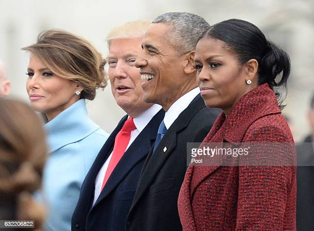 President Donald Trump First Lady Melania Trump former President Barack Obama and former First Lady Michelle Obama walk together following the...