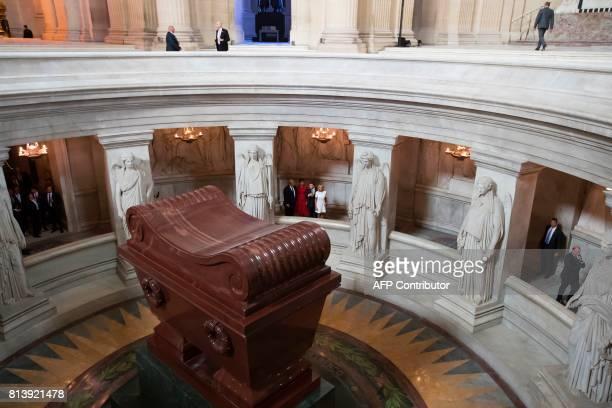 President Donald Trump, First Lady Melania Trump, French President Emmanuel Macron, and his wife Brigitte Macron visit Napoleon Bonaparte's tomb at...