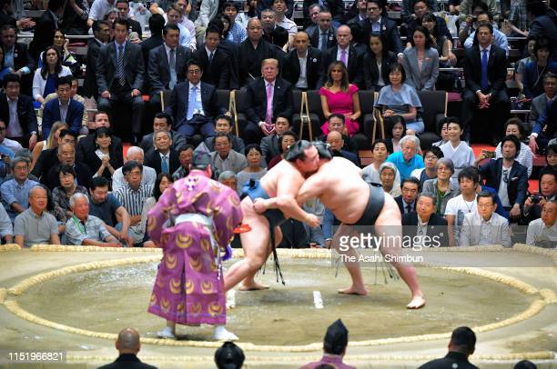 US President Donald Trump First Lady Melania Trump Japanese Prime Minister Shinzo Abe and his wife Akie watch sumo bouts on day fifteen of the Grand...