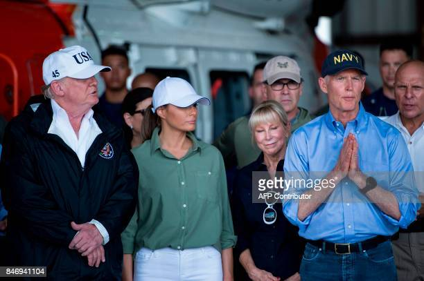 US President Donald Trump First Lady Melania Trump listen to Florida Governor Rick Scott as he speaks during a briefing on Hurricane Irma relief...