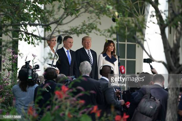 S President Donald Trump first lady Melania Trump President Andrzej Sebastian Duda of Poland and his wife Agata KornhauserDuda stop to pose for...