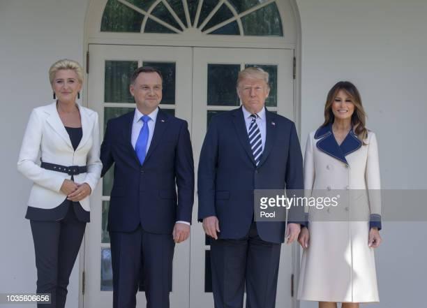 President Donald Trump , first lady Melania Trump , President Andrzej Sebastian Duda of Poland and his wife Agata Kornhauser-Duda pose after Duda's...