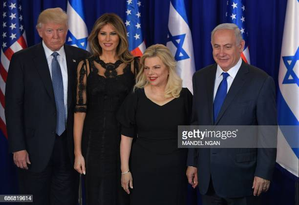 US President Donald Trump first lady Melania Trump Sara Netanyahu and Israel's Prime Minister Benjamin Netanyahu pose for pictures before an official...