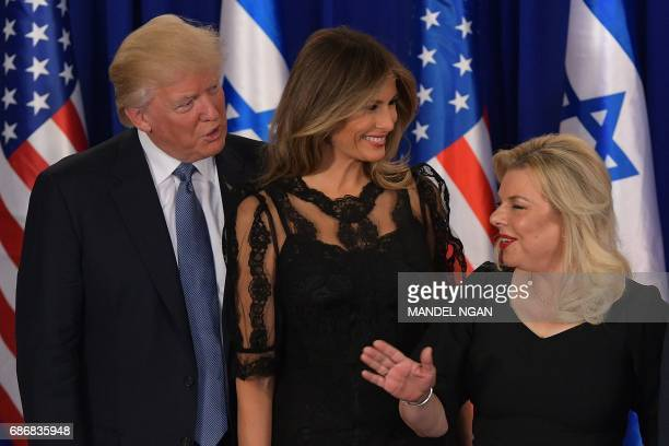 US President Donald Trump first lady Melania Trump Sara Netanyahu the wife of the Israeli prime minister share a laugh while posing for a photograph...
