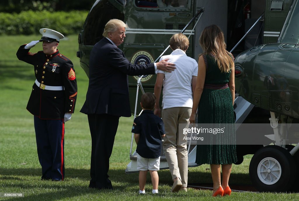 U.S. President Donald Trump (2nd L), first lady Melania Trump (R), son Barron (4th L) and grandson Joseph Frederick Kushner (3rd L) about to board the Marine One on the South Lawn of the White House prior to a departure August 25, 2017 in Washington, DC. President Trump is spending the weekend with his family at Camp David.