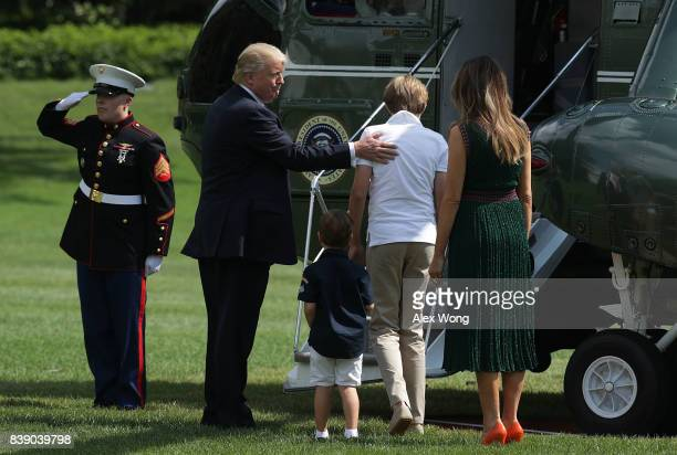 S President Donald Trump first lady Melania Trump son Barron and grandson Joseph Frederick Kushner about to board the Marine One on the South Lawn of...