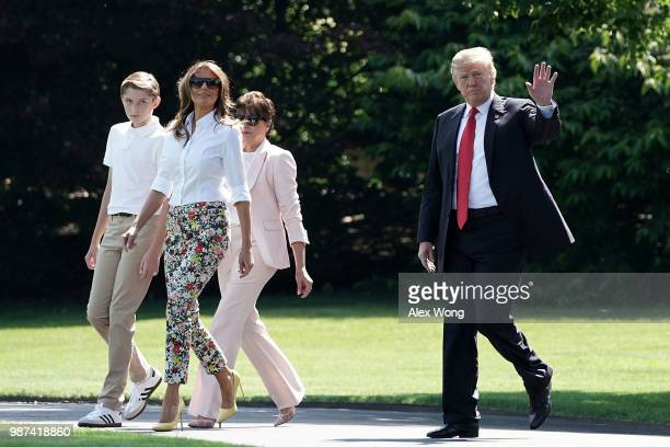 S President Donald Trump first lady Melania Trump their son Barron Trump and motherinlaw Amalija Knavs walk on the South Lawn of the White House...