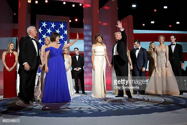 S President Donald Trump first lady Melania Trump US Vice President Mike Pence his wife Karen Pence and their families dance during the inaugural...