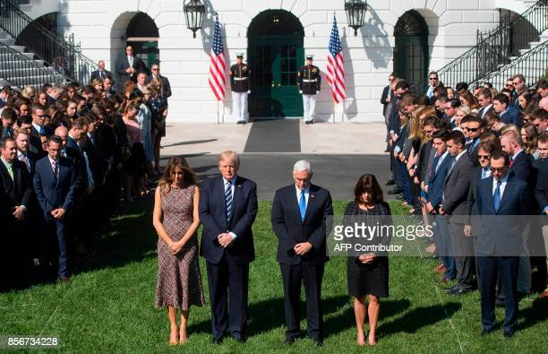 US President Donald Trump First Lady Melania Trump US Vice President Mike Pence and his wife Karen participate in a moment of silence on the South...