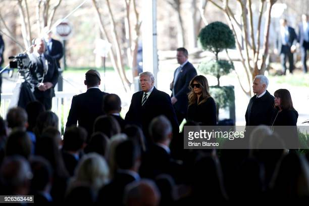 S President Donald Trump first lady Melania Trump US Vice President Mike Pence and his wife second lady Karen Pence arrive to join mourners paying...