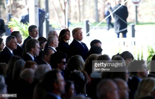 S President Donald Trump first lady Melania Trump US Vice President Mike Pence and his wife second lady Karen Pence join mourners paying their...