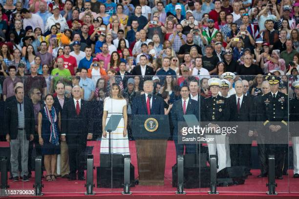 President Donald Trump First Lady Melania Trump Vice President Mike Pence and Second Lady Karen Pence stand on stage after President Donald Trump...