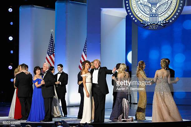 President Donald Trump first lady Melania Trump Vice President Mike Pence and his wife Karen dance with their families on stage at the Freedom...