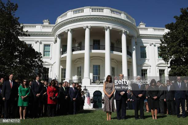 S President Donald Trump first lady Melania Trump Vice President Mike Pence and his wife Karen Pence lead a moment of silence for the victims of the...