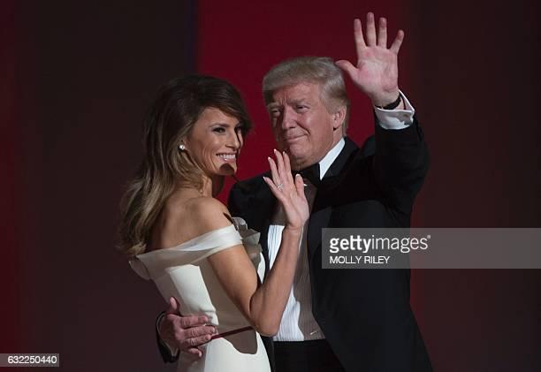 US President Donald Trump first lady Melania Trump wave at the Liberty Ball at the Washington DC Convention Center following Donald Trump's...