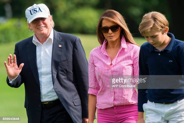 US President Donald Trump First Lady Melanie Trump and son Barron walk from Marine One upon arrival on the South Lawn of the White House in...