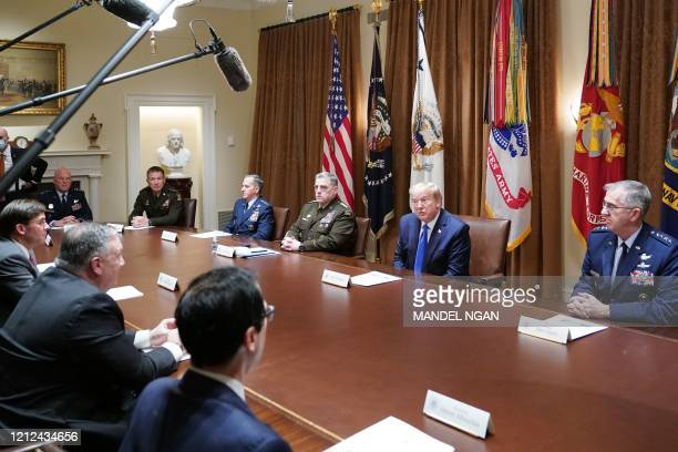 US President Donald Trump flanked by Chairman of the Joint Chiefs of Staff General Mark Milley and Vice Chairman of the Joint Chiefs of Staff General...