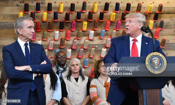 President Donald Trump , flanked by Chief Executive of LVMH Bernard Arnault, speaks during a visit to the new Louis Vuitton factory in Alvarado ,...