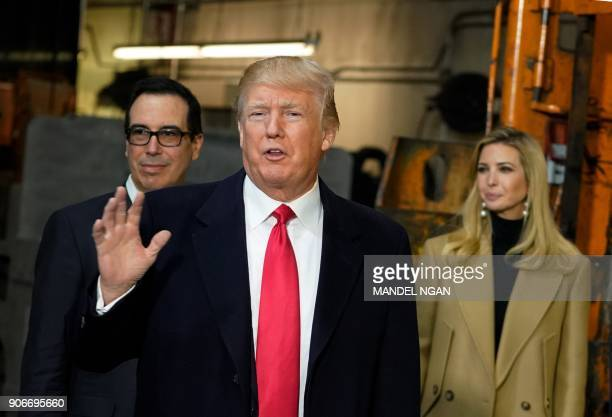 US President Donald Trump flanked by daughter Ivanka and Treasury Secretary Steven Mnuchin speaks during a tour of the HK Equipment Company in...