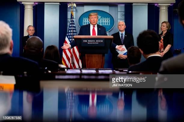 US President Donald Trump flanked by Director of the National Institute of Allergy and Infectious Diseases Anthony Fauci US Vice President Mike Pence...