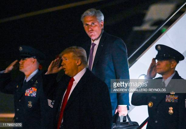US President Donald Trump flanked by House Minority Leader Kevin McCarthy arrive at John F Kennedy international airport to attend the Ultimate...