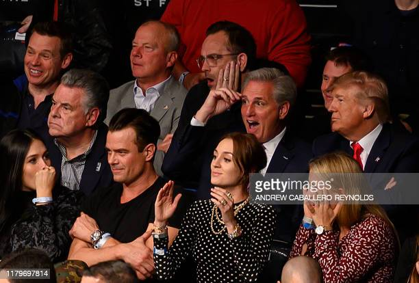 US President Donald Trump flanked by House Minority Leader Kevin McCarthy react as they watch the Ultimate Fighting Championship at Madison Square...