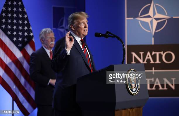 S President Donald Trump flanked by National Security Advisor John Bolton speaks to the media at a press conference on the second day of the 2018...