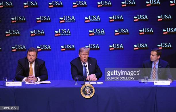 US President Donald Trump flanked by Nevada Senator Dean Heller and Nevada Attorney General Adam Laxalt speaks during a roundtable discussion on tax...