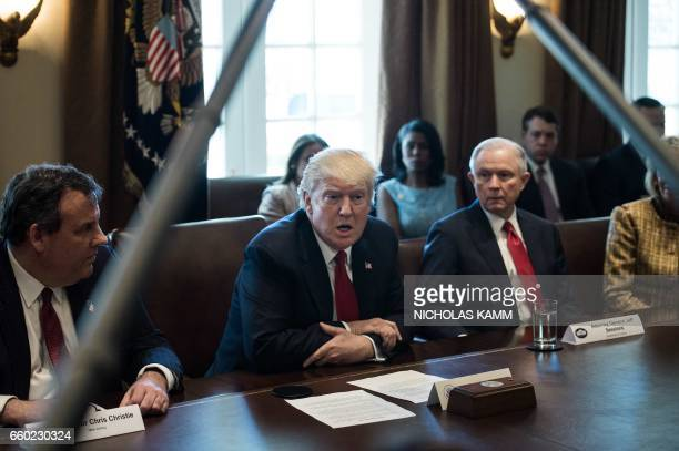 US President Donald Trump flanked by New Jersey Governor Chris Christie and Attorney General Jeff Sessions speaks during a meeting about opioid and...