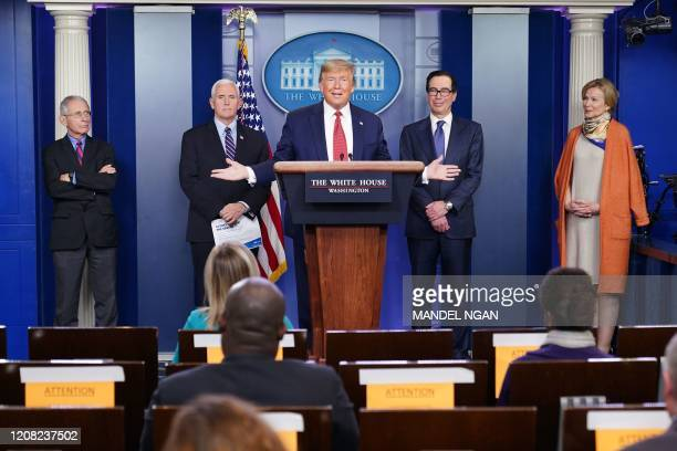 US President Donald Trump flanked by Response coordinator for White House Coronavirus Task Force Deborah Birx US Treasury Secretary Steven Mnuchin US...