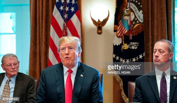 President Donald Trump, flanked by Senator Jim Inhofe , R-OK, and Mac Thornberry, R-TX, speaks during a meeting with Republican members of Congress...