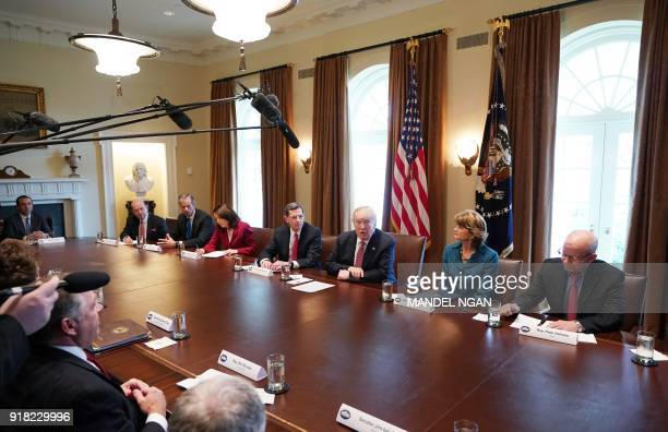 US President Donald Trump flanked by Senator John Barrasso and Senator Lisa Murkowski RAK speaks during a meeting with bipartisan members of Congress...