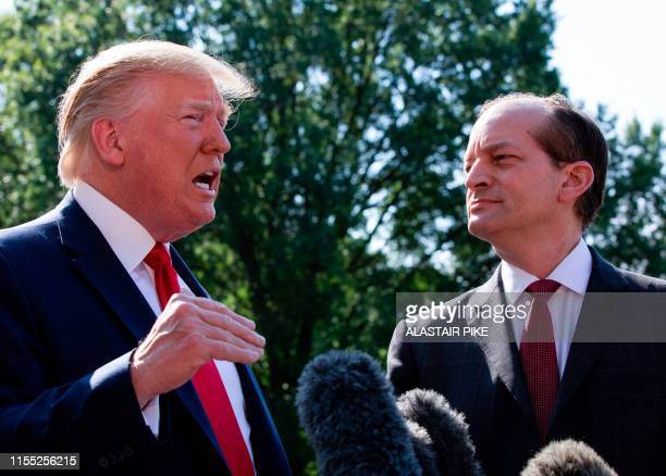 US President Donald Trump flanked by US Labor Secretary Alexander Acosta speaks to the media early July 12 2019 at the White House in Washington DC...