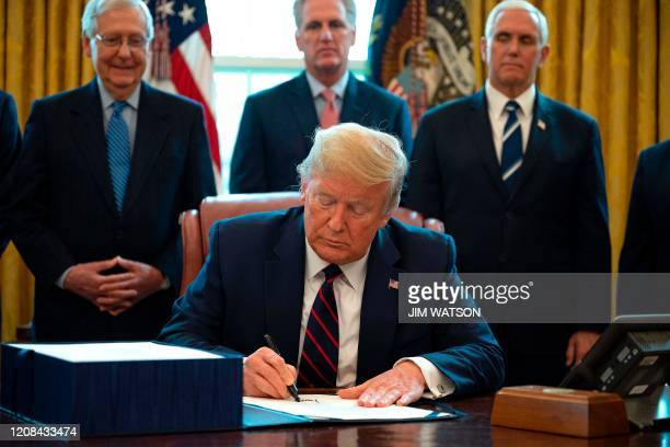 President Donald Trump, flanked by US Senate Majority Leader Mitch McConnell , House Minority Leader Kevin McCarthy and Vice President Mike Pence ,...