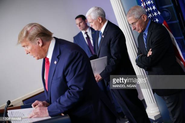 US President Donald Trump flanked by US Vice President Mike Pence and Director of the National Institute of Allergy and Infectious Diseases Anthony...