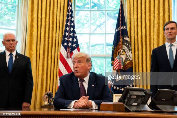 President Donald Trump, flanked by U.S. Vice President Mike Pence and Advisor Jared Kushner, speaks in the Oval Office to announce that Bahrain will...