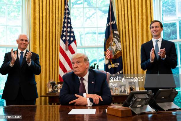 S President Donald Trump flanked by US Vice President Mike Pence and Advisor Jared Kushner speaks in the Oval Office to announce that Bahrain will...