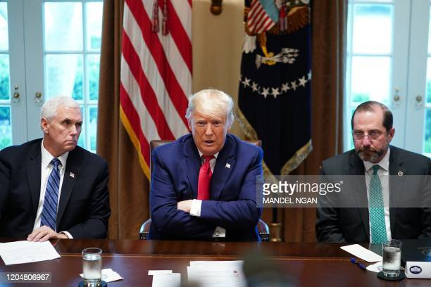 President Donald Trump flanked by Vice President Mike Pence , and Health and Human Services Secretary Alex Azar along with other members of the...