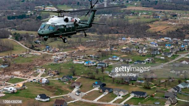 US President Donald Trump flies in Marine One over an area damaged in a tornado in Cookeville Tennessee on March 6 2020 Tornadoes ripped through...