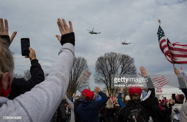 President Donald Trump flies in Marine-1 over a pro-Trump rally of supporters demonstrating against the election results, on December 12, 2020 in...