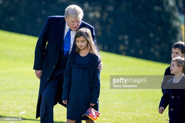 President Donald Trump, followed by his grandchildren, Arabella Kushner, Theodore Kushner, and Joseph Kushner get off Marine One on the south lawn of...