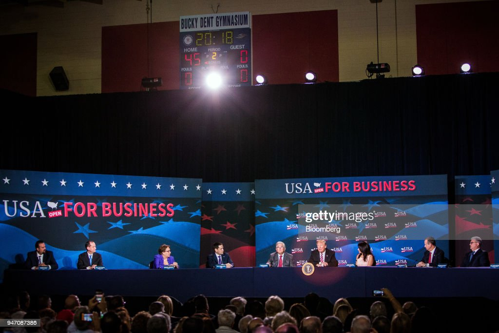 U.S. President Donald Trump, fourth right, speaks during roundtable discussion on tax cuts for Florida small businesses in Hialeah, Florida, U.S., on Monday, April 16, 2018. Trump accused China and Russia of devaluing their currencies, breaking from his own Treasury chief's view that no major trading partners are currency manipulators. Photographer: Scott McIntyre/Bloomberg via Getty Images